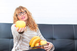 adult woman with fresh fruit
