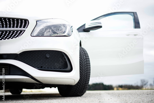 Front of modern white car - 255717889