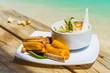 Quadro tropical dish with bananas and vegetables on tropical island in Aitutaki lagoon, Cook Islands. With selective focus.