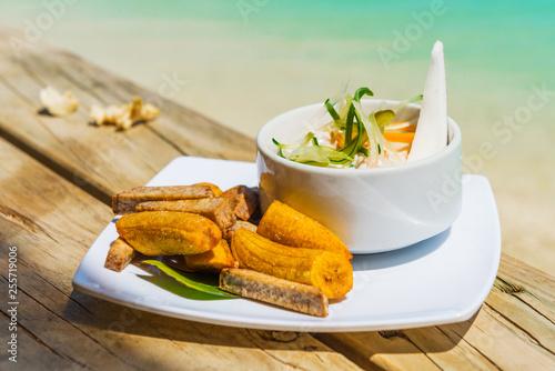 Leinwandbild Motiv tropical dish with bananas and vegetables on tropical island in Aitutaki lagoon, Cook Islands. With selective focus.
