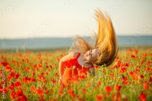 Child in a field with flowers - 255733248