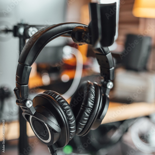 Close up view on professional headphone in sound recording studio. - 255734868