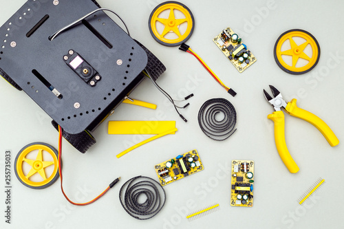 Foto Murales Robot on wheels and  yeloow tools. Flat lay