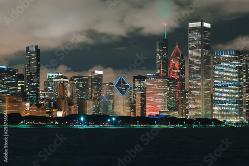Downtown Chicago cityscape skyline at night with Lake Michigan in the foreground - 255751646