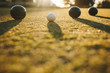 Close up shot of boules lying on ground