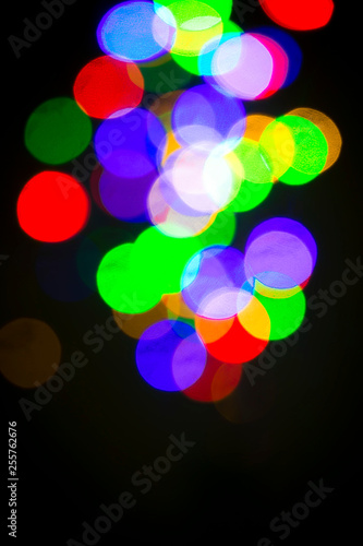 Colorful bokeh on a black background - 255762676