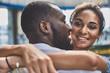 Joyful smiling woman embracing her beloved boyfriend