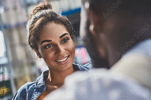Portrait of an attractive mixed race woman sanding with her boyfriend