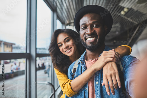 Cheerful handsome man making photos with his girlfriend