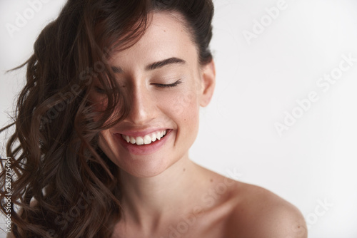 Close up of young smiling brunette woman