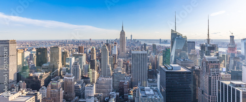Panoramic photo of New York City Skyline in Manhattan downtown with Empire State Building and skyscrapers on sunny day with clear blue sky USA - 255782281
