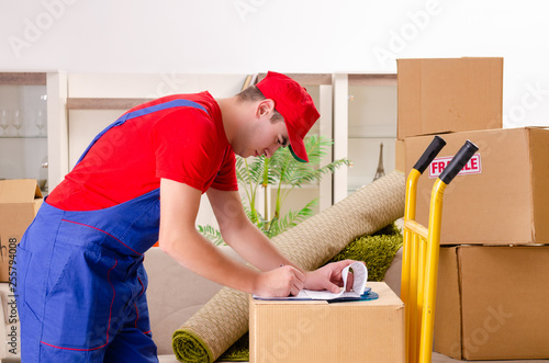 Leinwanddruck Bild Young contractor with boxes working indoors
