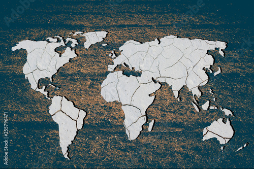 obraz lub plakat Roughly outlined world map with cracked soil background