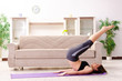 Leinwanddruck Bild - Young beautiful girl doing exercises at home
