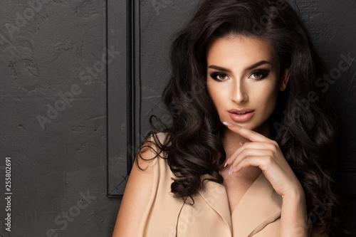 Portrait of beauty brunette woman in dark room
