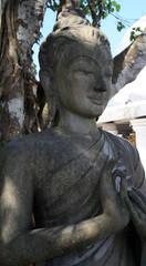 February 13, 2019. Phuket, Thailand. Stone Buddha statue near the huge sculpture of the Great white Buddha in Phuket. © taushka