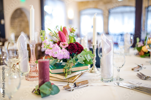 Leinwanddruck Bild Beautiful table decoration with fresh flowers and accessoires