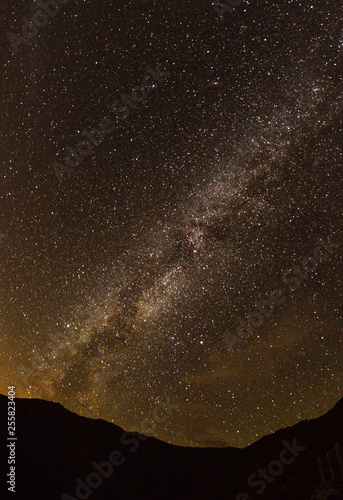 Nigh sky with many stars and milky way galaxy above a mountain © AM photos