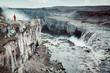 Leinwanddruck Bild - Hiker at gigantic Dettifoss waterfall in Iceland