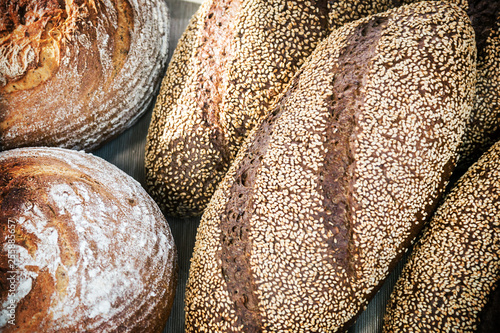 freshly baked bread with a delicious crust of seeds, flax and sesame seeds. background of bakery products