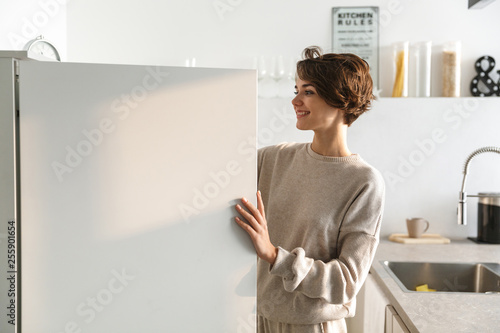 Leinwandbild Motiv Happy young woman standing