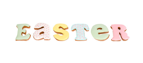 Homemade pastry biscuit letters for EASTER lettering, isolated on white background. © ArtCookStudio