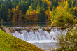 Small waterfall on the picturesque lake - 255917418