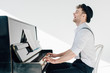 Leinwanddruck Bild - excited pianist in stylish clothing playing piano
