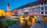 Historic city center of Erfurt with famous Krämerbrücke bridge illuminated at twilight, Thüringen, Germany