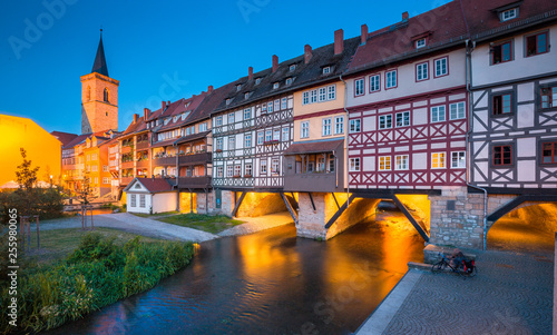 Leinwandbild Motiv Historic city center of Erfurt with famous Krämerbrücke bridge illuminated at twilight, Thüringen, Germany