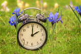 Daylight saving time. Alarm clock switched to summer time. Changing clock from wintertime to summertime. At 2 o'clock at night time is presented for one hour. Concept: energy saving