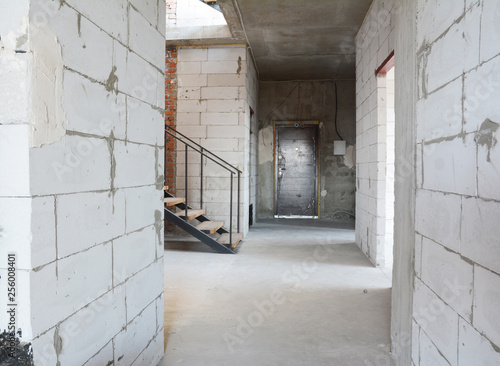 Aerated concrete blocks house corridor walls under construction ready for plastering and stucco - 256008401