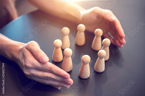 Woman hands defending his team with a gesture of protection, Security and safety in a business team. - 256027004