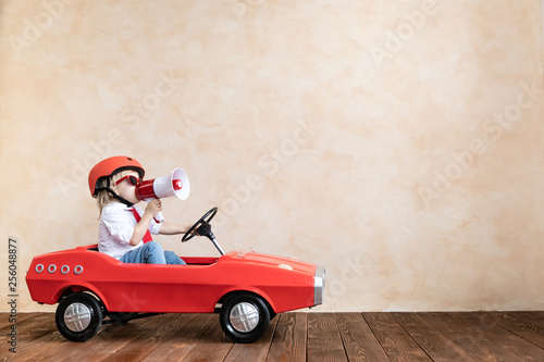 Funny kid driving toy car at home © Sunny studio