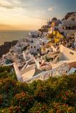 Santorini greece famous Oia in sunset time golden hour