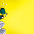 Leinwanddruck Bild - Top view composition with fitness equipment and space for text on bright yellow background. Sport lifestyle concept with sneakers, dumbbell, bottle of water and headphones. Copy space, flat lay