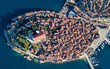 Aerial shot of an old Croatian coastal town Rovinj. Located on the western coast of the Istrian peninsula, it is a popular tourist resort and an active fishing port - 256065279