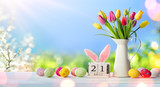 Fototapeta Tulipany - Easter - Calendar Date With Decorated Eggs And Tulips In Sunny Garden © Romolo Tavani