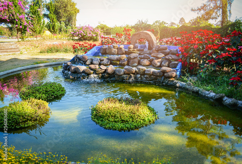 Leinwanddruck Bild beautiful pond water garden landscape pond design small waterfall stone with plant