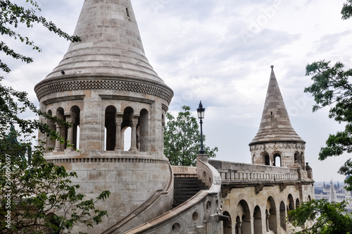 obraz lub plakat Public Park. Budapest- Fisherman's Bastion is a neo-Gothic and neo-Romanesque style structure situated on the Castle hill in Budapest. Shot on a rainy day.