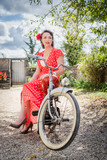 beautiful vintage woman on red moped