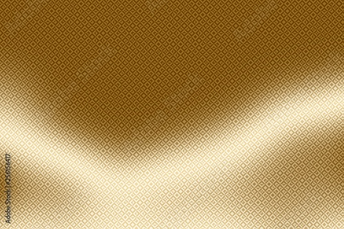 golden background and gold print on shiny foil, metallic.