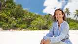 people and summer concept - happy smiling woman over seychelles island tropical beach background