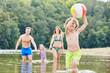 Leinwanddruck Bild - Junge mit einem Ball spielt ausgelassen im Meer