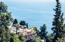 "Постер, картина, фотообои ""Luxury resort with a swimming pool and sea view in Taormina, Sicily, Italy."""