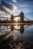 The iconic Tower Bridge of London, UK, during sunset with reflections in a puddle of water