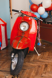 Retro red scooter  in oldschool vintage interior with air balloons