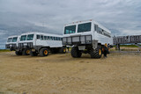 tundra buggy waiting for tourists to watch polar bears in churchill, manitoba