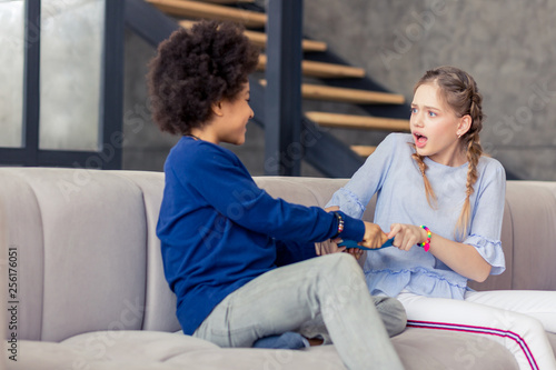 Shocked blonde teenager staring at her friend