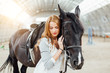 girl with a horse on the racetrack - 256176808